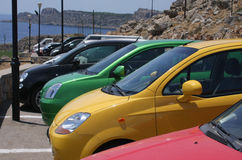 Estacionamiento colorido compacto del coche Imagen de archivo libre de regalías