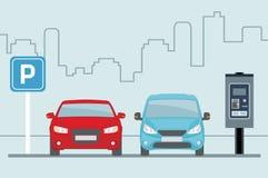 Estacionamiento con dos coches y terminales para pagar en fondo azul claro foto de archivo