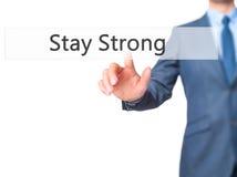 Estada forte - botão da pressão de mão do homem de negócios no tela táctil mim imagens de stock royalty free