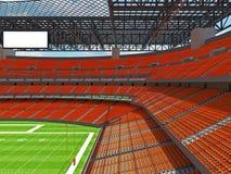 Estadio de fútbol americano moderno con los asientos anaranjados Imagen de archivo