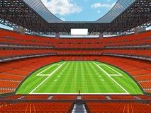 Estadio de fútbol americano moderno con los asientos anaranjados Fotos de archivo libres de regalías