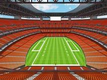 Estadio de fútbol americano moderno con los asientos anaranjados Imagen de archivo libre de regalías