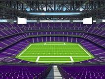 Estadio de fútbol americano moderno con los asientos púrpuras Foto de archivo
