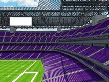 Estadio de fútbol americano moderno con los asientos púrpuras Foto de archivo libre de regalías