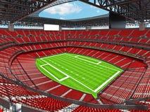 Estadio de fútbol americano moderno con los asientos rojos Imagen de archivo libre de regalías