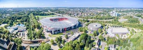 Estadio de fútbol en el sol, aéreo Foto de archivo libre de regalías