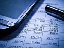 Estado financiero y PDA foto de archivo libre de regalías