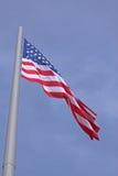 Estados Unidos señalan por medio de una bandera Foto de archivo