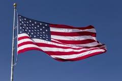 Estados Unidos señalan por medio de una bandera Fotografía de archivo libre de regalías