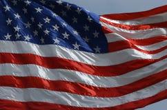 Estados Unidos señalan por medio de una bandera Imágenes de archivo libres de regalías