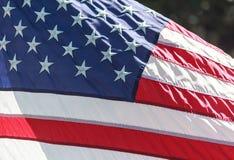 Estados Unidos señalan por medio de una bandera Imagen de archivo libre de regalías