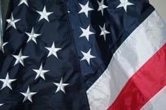 Estados Unidos señalan por medio de una bandera Fotografía de archivo