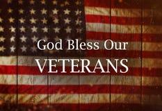 Estados Unidos señalan por medio de una bandera Concepto del día de veteranos Foto de archivo libre de regalías
