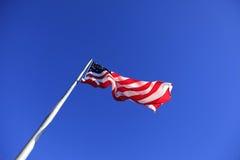 Estados Unidos señalan por medio de una bandera en la roca de la chimenea imagen de archivo