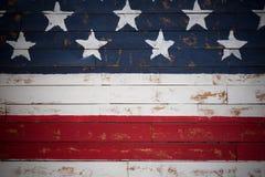Estados Unidos señalan por medio de una bandera pintado en los tablones de madera que forman un fondo Foto de archivo