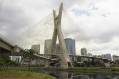 Estaiada Bridge, Pinheiros River and skyscrapers in Sao Paulo, Brazil. The Octavio Frias de Oliveira bridge is a cable-stayed bridge in São Paulo, Brazil over royalty free stock photography