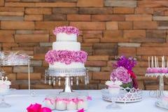 Estallidos y magdalenas de la torta Foto de archivo