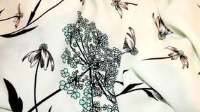 Estampado de flores hermoso en tela Foto de archivo libre de regalías