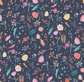 Estampado de flores inconsútil floral colorido en un fondo oscuro Fotos de archivo libres de regalías
