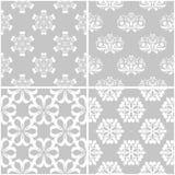 Estampados de flores Sistema de fondos inconsútiles grises y blancos Fotografía de archivo libre de regalías