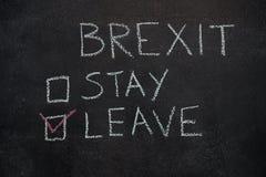 Estancia o licencia de Brexit en la pizarra negra Fotografía de archivo libre de regalías