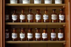Estante con las botellas Imagen de archivo libre de regalías