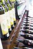 Estantes con el vino Foto de archivo libre de regalías
