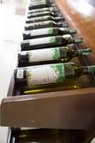 Estantes con el vino Fotos de archivo libres de regalías