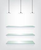 Estantes de cristal con la luz del punto Foto de archivo libre de regalías