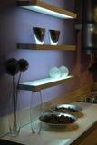 Estantes de cristal iluminados Imagen de archivo libre de regalías