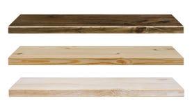 Estantes de madera de diverso color aislados en blanco Fotos de archivo libres de regalías