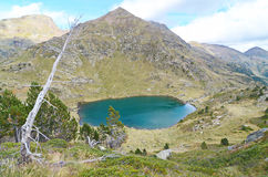 Estany de Mes Amunt - one of the three lakes of Tristaina. (Estanys de Tristaina) in Andorra near the Ordino-Arcalis ski resort in the spring Royalty Free Stock Images