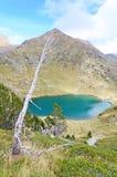 Estany de Mes Amunt - one of the three lakes of Tristaina. (Estanys de Tristaina) in Andorra near the Ordino-Arcalis ski resort in the spring Stock Photos