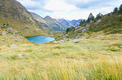 Estany de Mes Amunt - one of the three lakes of Tristaina. (Estanys de Tristaina) in Andorra near the Ordino-Arcalis ski resort in the spring Royalty Free Stock Photo