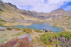 Estany Primer - one of the three lakes of Tristaina. (Estanys de Tristaina) in Andorra near the Ordino-Arcalis ski resort in the spring Royalty Free Stock Photography