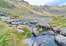 Estany Primer - one of the three lakes of Tristaina. (Estanys de Tristaina) in Andorra near the Ordino-Arcalis ski resort in the spring Royalty Free Stock Images