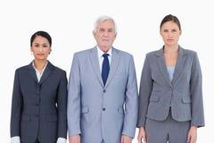 Estar de três empresários Fotografia de Stock Royalty Free