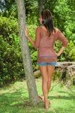 Estar por uma árvore Fotos de Stock Royalty Free