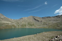 Estaris lake in Alps Stock Images