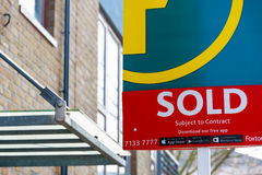 Estate agency sold sign outside a English townhouse Royalty Free Stock Image