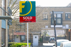 Estate agency sold sign outside a English townhouse. London, UK - March 27, 2017 - Estate agency sold sign outside a English townhouse Royalty Free Stock Images