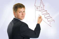 Estate agent. Drawing plan for new aim Stock Images