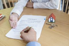 Estate agent with customer after contract signature of buying house royalty free stock photo