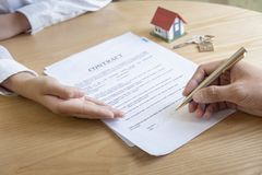 Estate agent with customer after contract signature of buying house stock photos