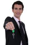 Estate-agent dangling  keys Royalty Free Stock Images