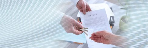 Real estate transaction; panoramic banner. Estate agent giving house keys and contract to customer; panoramic banner royalty free stock photography
