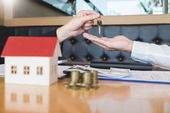 Estate agent giving house keys customer sign agreement property for sale, Buying and selling homes concept royalty free stock photos
