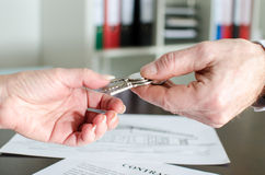 Estate agent giving house keys to customer Royalty Free Stock Images
