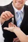 Estate agent giving house keys to man Royalty Free Stock Images