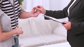 Estate agent giving key to couple stock footage